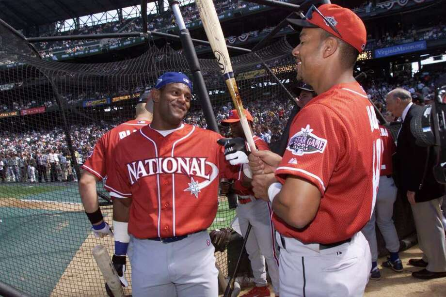 10 Jul 2001:  Sammy Sosa of the Chicago Cubs chats with Moises Alou of the Houston Astros during batting practice for the 2001 Major League Baseball All-Star Game at Safeco Field in  Seattle, Washington. DIGITAL IMAGE. Mandatory Credit:  Jed Jacobsohn/Allsport Photo: Jed Jacobsohn, Getty Images / Getty Images North America