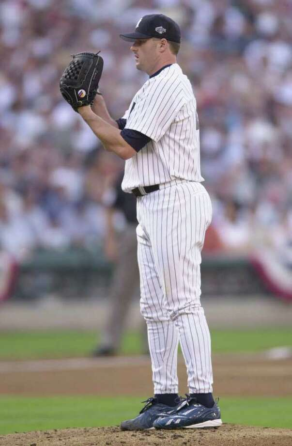 10 Jul 2001: Roger Clemens of the New York Yankees prepares to pitch for the American League during the 2001 Major League Baseball All-Star game at Safeco Field in Seattle, Washington, won by the American League 4-1. DIGITAL IMAGE Mandatory  Credit: Otto Gruele/Allsport Photo: Otto Greule Jr, Getty Images / Getty Images North America
