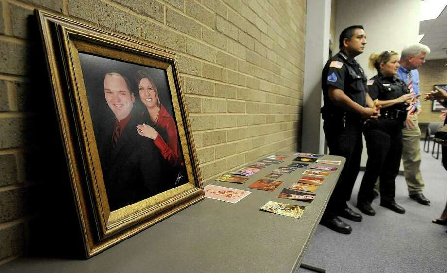 Beaumont and county peace officers stand next to a table topped with photos of Bryan Hebert after a press conference Monday. Guiseppe Barranco/The Enterprise Photo: Guiseppe Barranco