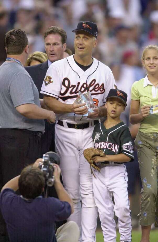 10 Jul 2001:  Cal Ripken Jr. of the Baltimore Orioles holds the Most Valuable Player trophy with son Ryan and daughter Rachel by his side after the 2001 Major League Baseball All-Star Game at Safeco Field in  Seattle, Washington. DIGITAL IMAGE. Mandatory Credit: Otto Greule/Allsport Photo: Otto Greule Jr, Getty Images / Getty Images North America
