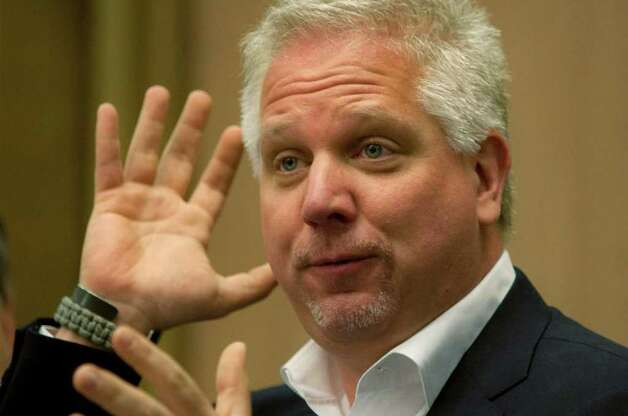 U.S. TV commentator Glenn Beck gestures as he speaks in the Knesset, Israel's parliament, in Jerusalem, Monday, July 11, 2011. Conservative U.S. television commentator Glenn Beck received several rounds of applause by Israeli lawmakers as he voiced his unequivocal support for Israel during a visit to Jerusalem. He spoke Monday before a packed parliamentary committee. (AP Photo/Sebastian Scheiner) Photo: Sebastian Scheiner / AP
