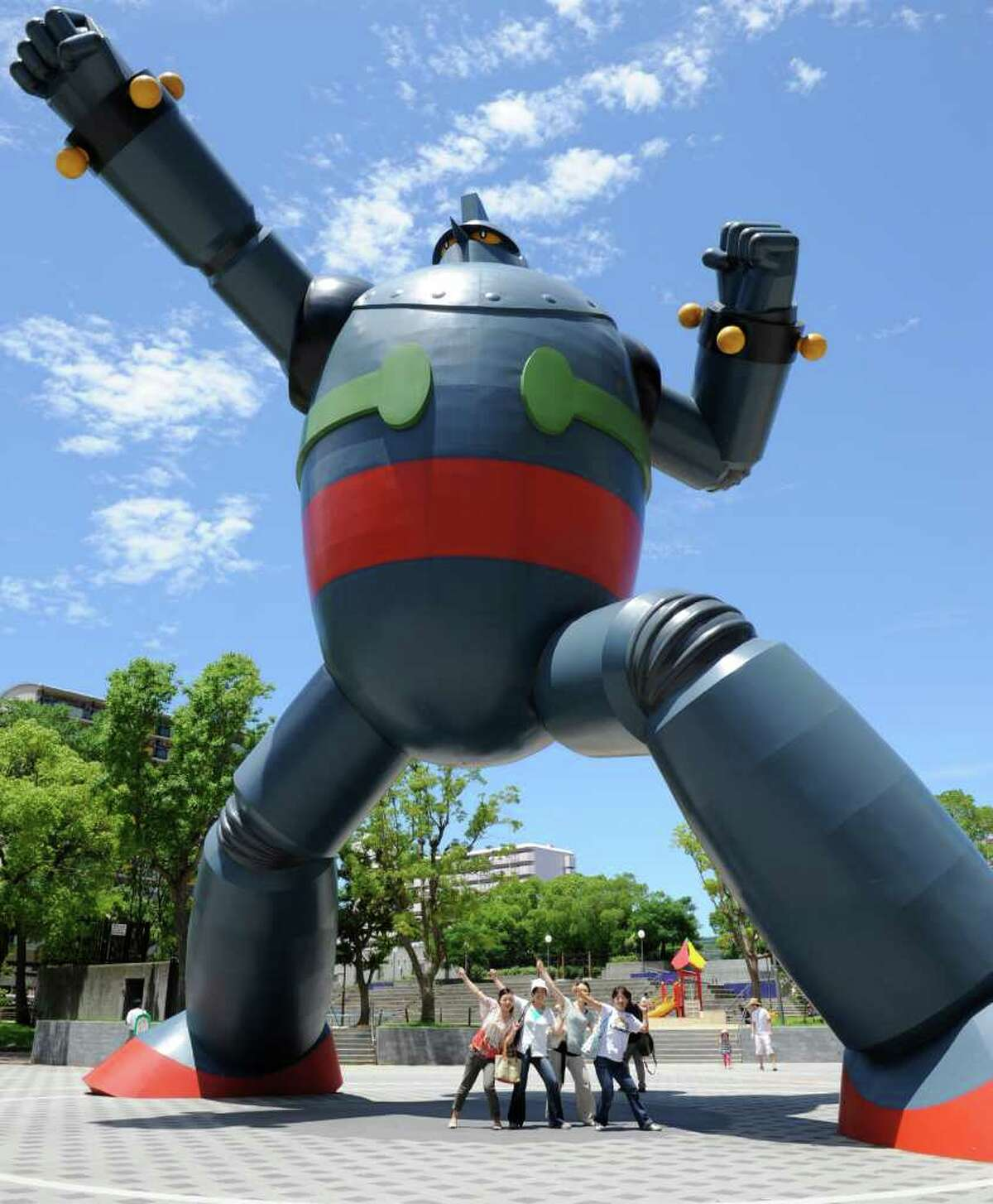 Tourists pose with a 15.3 metre-tall 'Tetsujin 28-go', or 'Iron Man 28' at Wakamatsu park in Kobe, Japan. The statue was built to commemorate its manga creator, Mitsuteru Yokoyama who born in Kobe.