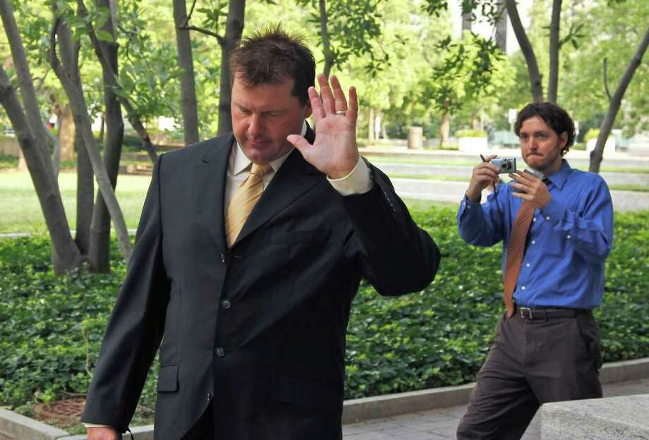 Former Major League Baseball pitcher Roger Clemens, left, waves as he arrives at federal court in Washington, Monday, July 11, 2011,  for his trial on charges of lying to Congress in 2008 when he denied ever using performance-enhancing drugs. (AP Photo/Alex Brandon) Photo: Alex Brandon, STF / AP