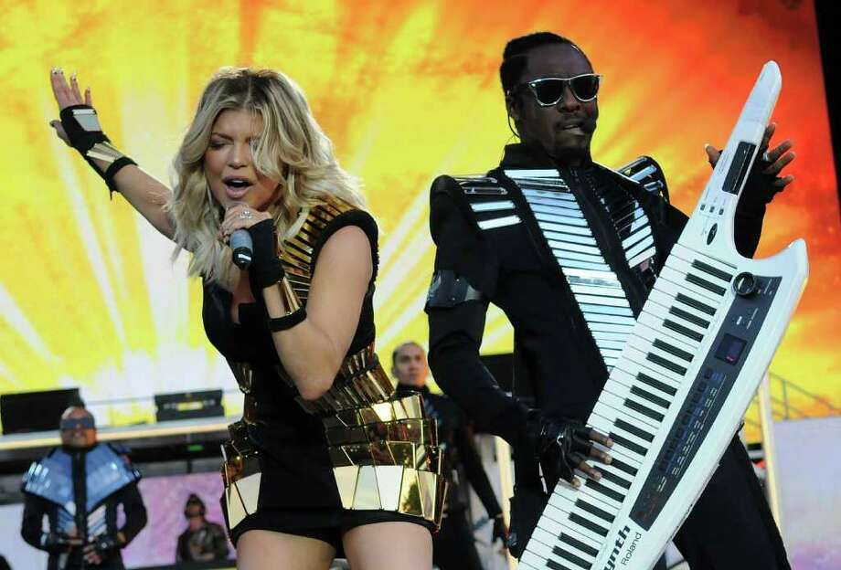 LONDON, ENGLAND - JULY 01:  Fergie and will.i.am of The Black Eyed Peas perform live on stage during the first day of the Wireless Festival at Hyde Park on July 1, 2011 in London, England.  (Photo by Jim Dyson/Getty Images) Photo: Jim Dyson, Stringer / 2011 Getty Images