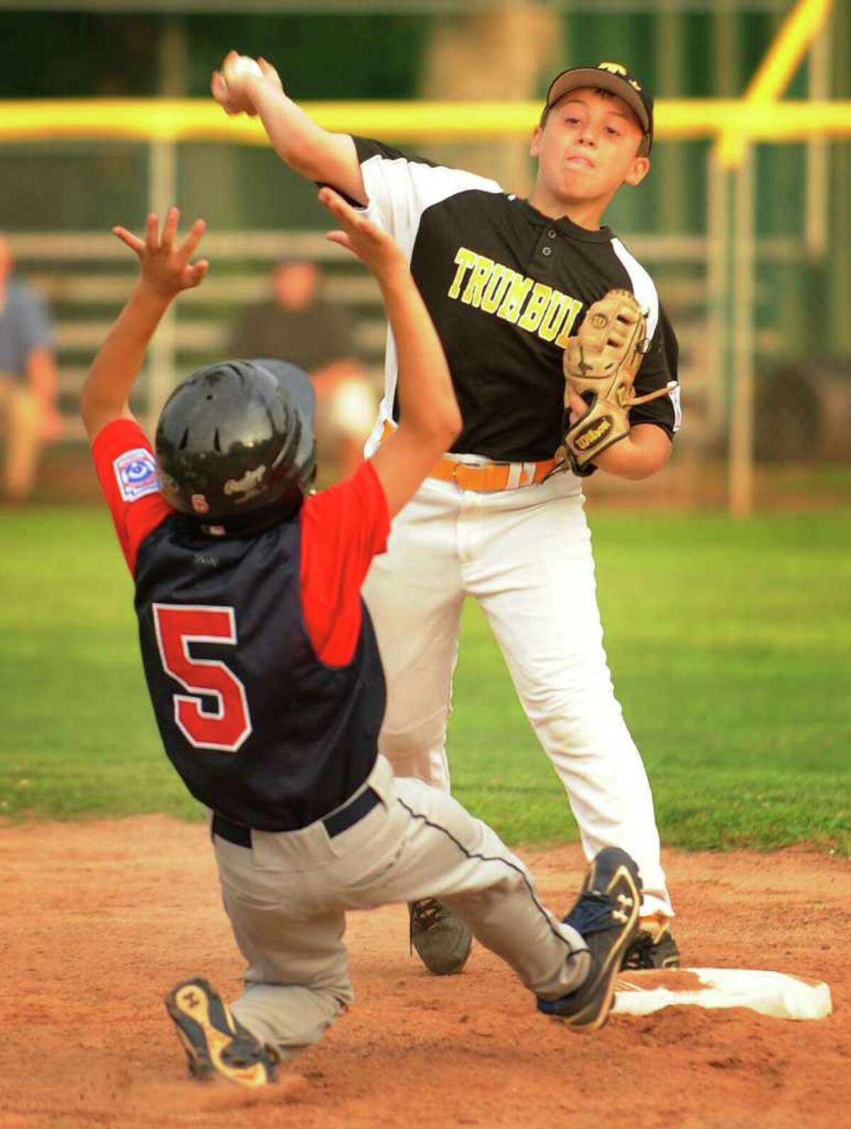 Fairfield National's Jono Zarrilli is forced out at second by Trumbull American's Jake Bova in the sixth inning of their Little League matchup at Blackham School in Bridgeport on Monday, July 11, 2011. Fairfield National won the game 4-3.