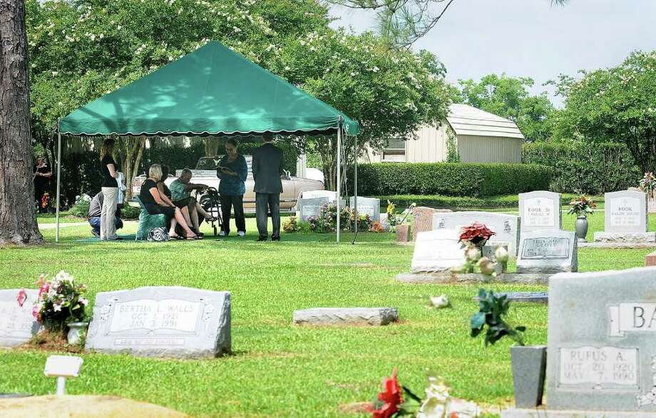 A small group of friends and employees from a nursing home attend a the funeral of a person with no family and few friends when he died in June, 2010. In many cases the county pays for the  burial. Enterprise file photo Photo: File / Beaumont