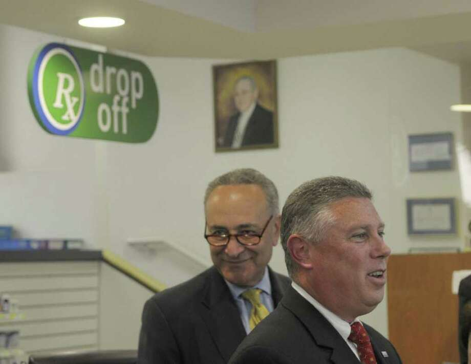 Cohoes Mayor  John McDonald, foreground, introduces Senator Charles Schumer during a press conference at Marra's Pharmacy on Monday, July 11, 2011 in Cohoes.  McDonald, who is also a pharmacist owns Marra's Pharmacy.  Senator Schumer held the press event to announce legislation that would address overprescribing of narcotics and increase penalties for pharmacy drug thefts.  (Paul Buckowski / Times Union) Photo: Paul Buckowski  / 00013871A