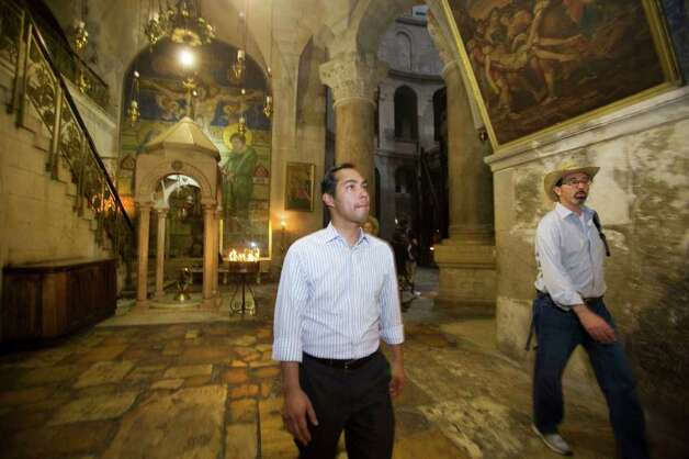 San Antonio, Texas mayor Julian Castro, center, stands in the Church of the Holy Sepulchre, traditionally believed by many Christians to be the site of the crucifixion and burial of Jesus Christ, during his visit to Jerusalem's Old city, Monday, July 11, 2011. (AP Photos/Dan Balilty) Photo: Dan Balilty, Express-News / AP