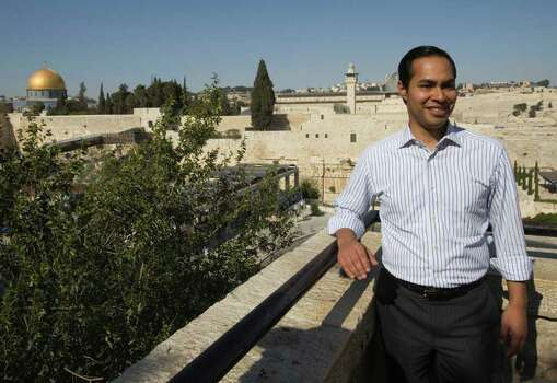 With the Dome of the Rock Mosque in the background, left, San Antonio, Texas mayor Julian Castro poses for a photograph as he visits Jerusalem's Old city, Monday, July 11, 2011. (AP Photos/Dan Balilty) Photo: Dan Balilty, Express-News / AP
