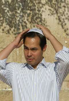 San Antonio, Texas mayor Julian Castro stands at Western Wall, the holiest site where Jews can pray, during his visit of Jerusalem's Old city, Monday, July 11, 2011. (AP Photos/Dan Balilty) Photo: Dan Balilty, Express-News / AP