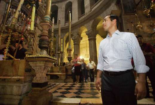 San Antonio, Texas mayor Julian Castro, right, stands in the Church of the Holy Sepulchre, traditionally believed by many Christians to be the site of the crucifixion and burial of Jesus Christ, during his visit to Jerusalem's Old city, Monday, July 11, 2011. (AP Photos/Dan Balilty) Photo: Dan Balilty, Express-News / AP