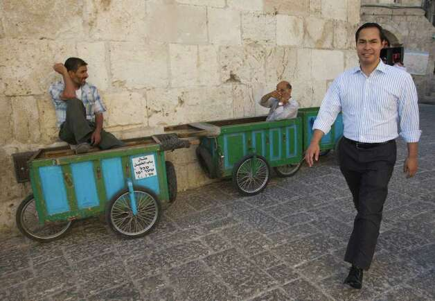 San Antonio, Texas mayor Julian Castro, right, walks in Jerusalem's Old city, Monday, July 11, 2011. (AP Photos/Dan Balilty) Photo: Dan Balilty, Express-News / AP