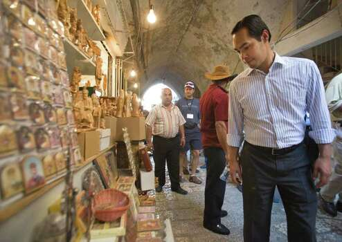 San Antonio, Texas mayor Julian Castro walks by a souvenir shop during his visit in Jerusalem's Old city, Monday, July 11, 2011. (AP Photos/Dan Balilty) Photo: Dan Balilty, Express-News / AP