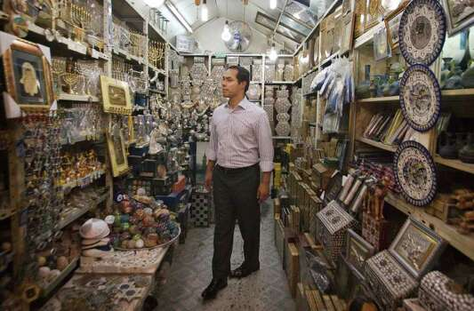 San Antonio, Texas mayor Julian Castro visits a souvenir shop in Jerusalem's Old city, Monday, July 11, 2011. (AP Photos/Dan Balilty) Photo: Dan Balilty, Express-News / AP