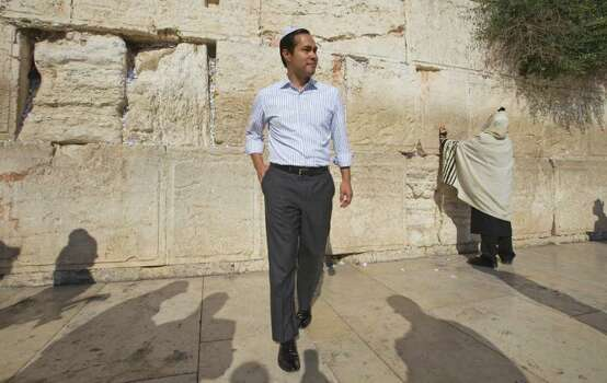 San Antonio, Texas mayor Julian Castro walks away from the Western Wall, the holiest site where Jews can pray, during his visit of Jerusalem's Old city, Monday, July 11, 2011. (AP Photos/Dan Balilty) Photo: Dan Balilty, Express-News / AP