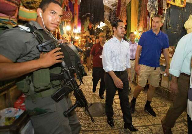 San Antonio, Texas mayor Julian Castro, center, walks through the market as he visits Jerusalem's Old city, Monday, July 11, 2011. (AP Photos/Dan Balilty) Photo: Dan Balilty, Express-News / AP