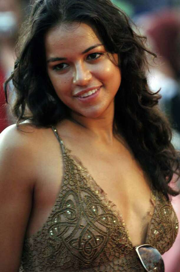 "**FILE**Michelle Rodriguez, one of the new cast members of ABC's television series ""Lost,"" poses on the red carpet before a screening of the series' first episode of the second season, on Waikiki Beach in Honolulu  Sept. 14, 2005. Photo: LUCY PEMONI, AP / AP"