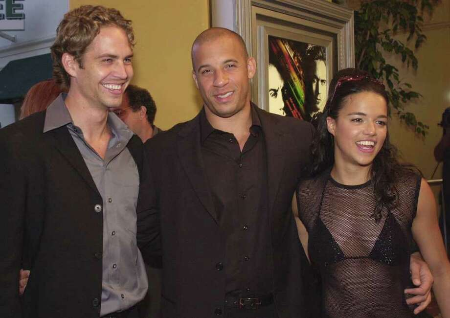 "Cast members from Universal Pictures' ""The Fast and the Furious,"" from left, Paul Walker, Vin Diesel, and Michelle Rodriguez, arrive at the world premiere of the film Monday, June 18, 2001, in the Westwood section of Los Angeles. Photo: CHRIS WEEKS, AP / AP"