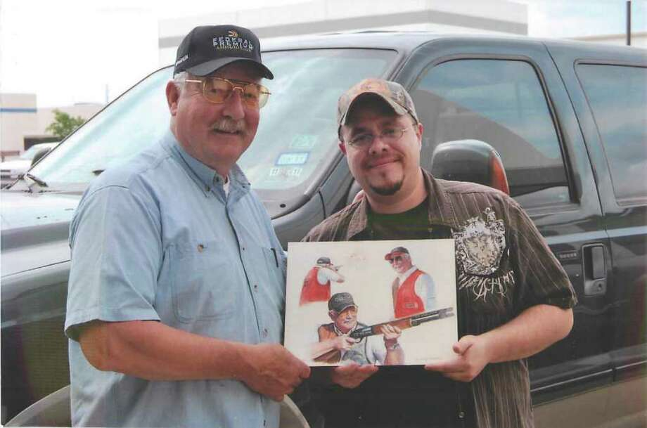 Tom Knapp with local artist Calvin Carter with a sample rendering Carter created for Knapp