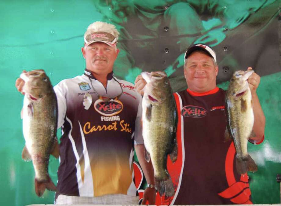 Two over 8 lbs to anchor a 20.88 lb three fish limit and take the win for Brian Bridges and Pete Lowe.  They also won Big Bass honors with their 8.36 lb kicker.  Photo by Lakecaster Managing Editor Patty Lenderman