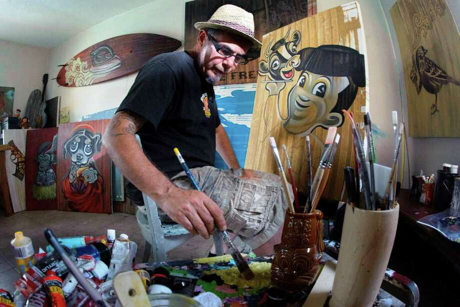 "Robert Tatum works in his studio on a painting called ""Bob's Big Barbacoa."" The San Antonio artists frequently uses icons from the 1960s in his work. Photo: Steve Thurow Photos"