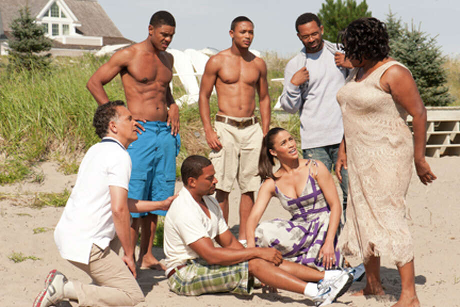 "(L-R) Brian Stokes Mitchel as Mr. Watson, DeRay Davis as Malcolm, Laz Alonso as Jason Taylor, Romeo Miller as Sebastian, Paula Patton as Sabrina Watson, Mike Epps as Willie Earl and Loretta Devine as Mrs. Taylor in ""Jumping the Broom."""