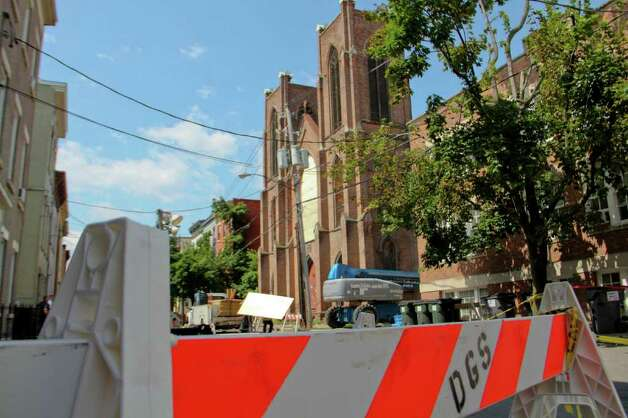 Trinity Church on Trinity Place, Albany, suffered a series of recent structural collapses. Crews work to get the structure safely down on Tuesday, July 12, 2011. (Erin Colligan / Special To The Times Union) / 00013889A