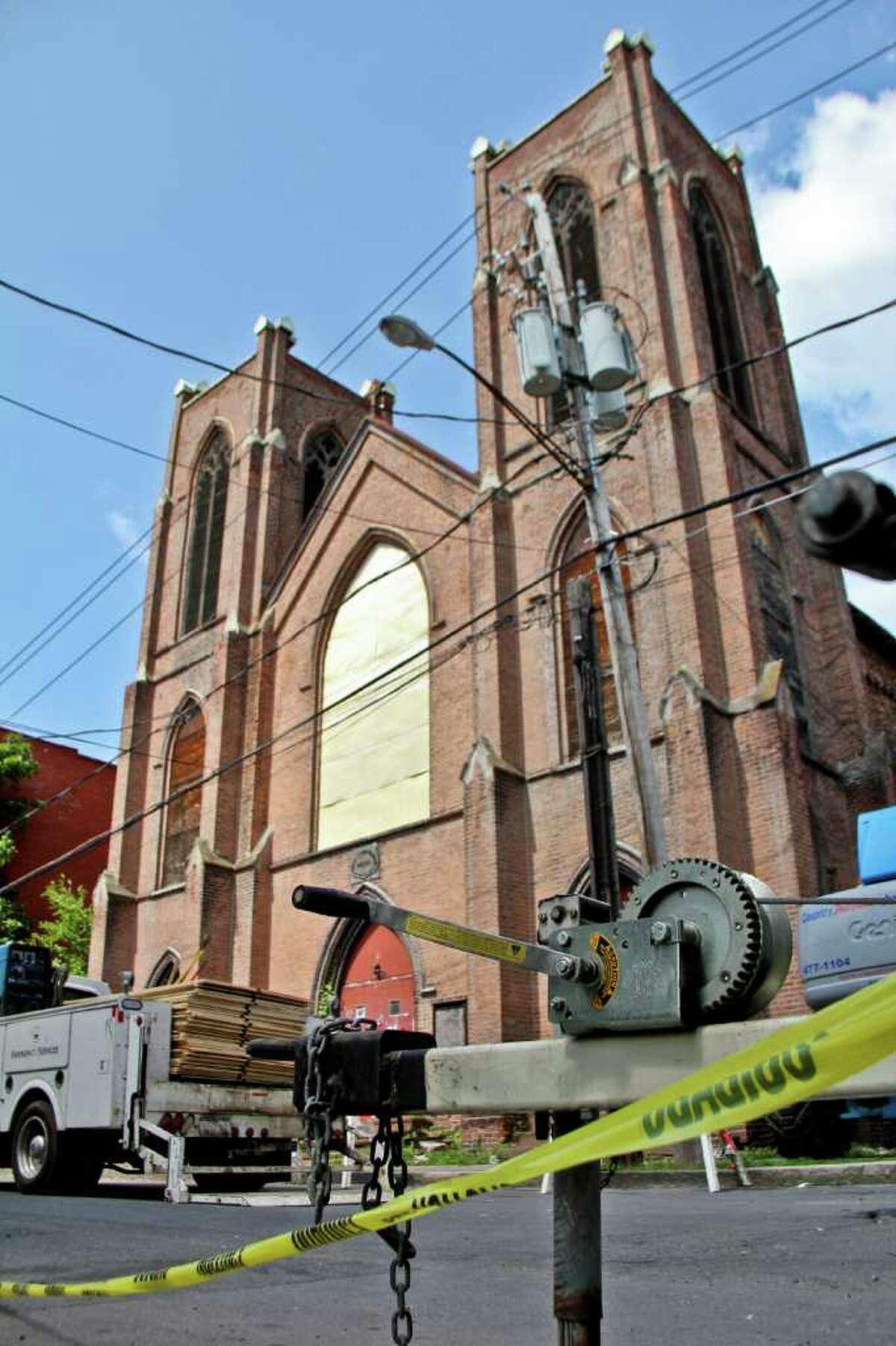 Trinity Church on Trinity Place, Albany, suffered a series of recent structural collapses. Crews work to get the structure safely down on Tuesday, July 12, 2011. (Erin Colligan / Special To The Times Union)