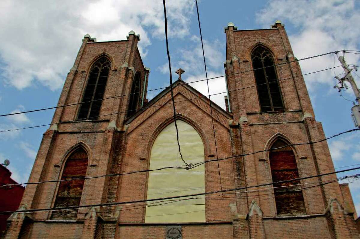 The front of Trinity Church on Trinity Place, Albany, which suffered a series of recent structural collapses. Crews work to get the structure safely down on Tuesday, July 12, 2011. (Erin Colligan / Special To The Times Union)