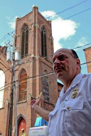 Chief Robert Forezzi of the Albany Fire Department outside of Trinity Church on Trinity Place, Albany, on Tuesday, July 12, 2011. The church suffered a series of recent structural collapses and crews are working to get the structure safely down . (Erin Colligan / Special To The Times Union)
