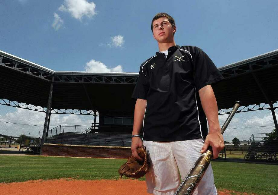 Nederland's Dillon Duplant is the Super Gold Player of the Year. Duplant was 9-0 with a 0.58 ERA on the mound and hit .377 with four home runs and 24 RBIs. Guiseppe Barranco/The Enterprise Photo: Guiseppe Barranco