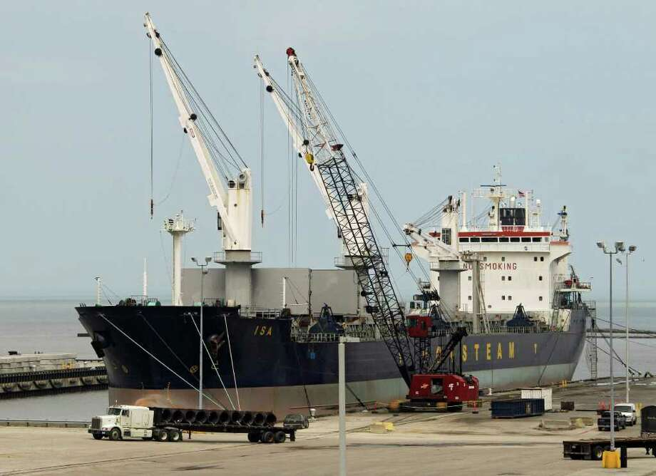 """In this May 19, 2011 photo, steel coils are unloaded from the Polish ship """"Isa"""" at the Port of Cleveland. The Commerce Department said Tuesday, July 12, 2011, the deficit increased 15.1 percent to $50.2 billion in May. That's the largest imbalance since October 2008. (AP Photo/Mark Duncan) Photo: Mark Duncan, STF / AP"""