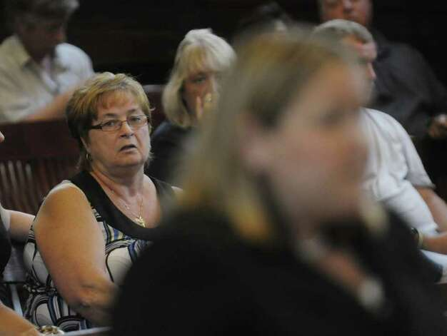 Colleen Barkman, left, an aunt of Michael Mosley listens as Christa Book, Rensselaer County assistant district attorney, addresses the court in Judge Robert Jacon's courtroom at the Rensselaer County Courthouse on Tuesday morning, July 12, 2011 in Troy.  Michael Mosley was sentenced to life for the murders of Samuel Holley and Arica Lynn Schneider.  (Paul Buckowski / Times Union) Photo: Paul Buckowski  / 00013874A