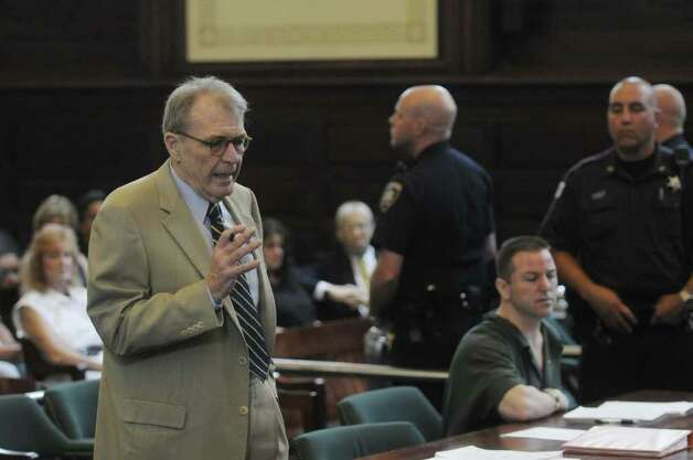 Defense attorney Terence Kindlon, foreground left, addresses the court on behalf of his client Michael Mosley, right, in Judge Robert Jacon's courtroom at the Rensselaer County Courthouse on Tuesday morning, July 12, 2011 in Troy.  Michael Mosley was sentenced to life for the murders of Samuel Holley and Arica Lynn Schneider.  (Paul Buckowski / Times Union) Photo: Paul Buckowski  / 00013874A