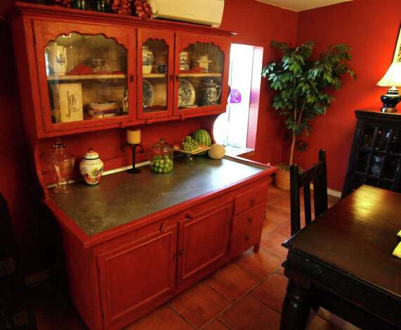 "Roland and Genny Rodriguez's kitchen has recently been remodeled to an eclectic style they call ""new Italian country."" Photo: OMAR PEREZ, San Antonio Express-News / SAN ANTONIO EXPRESS-NEWS"
