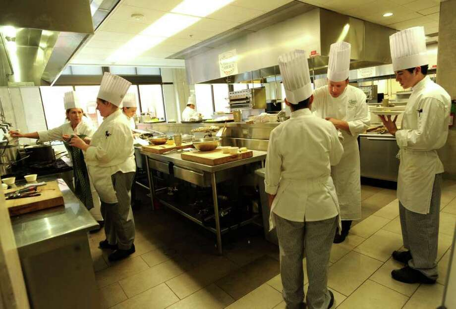 Michael Katz, second from right, supervises students at The Culinary Institute of America on June 24, 2011. BILLY CALZADA / gcalzada@express-news.net