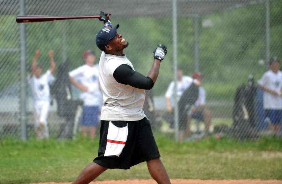 Bridgeport Bluefish infielder Angel Berroa shows off his hitting power as guest coach during Baseball World Training Camp Friday, July 8, 2011 in Westport, Conn. Photo: Autumn Driscoll / Connecticut Post