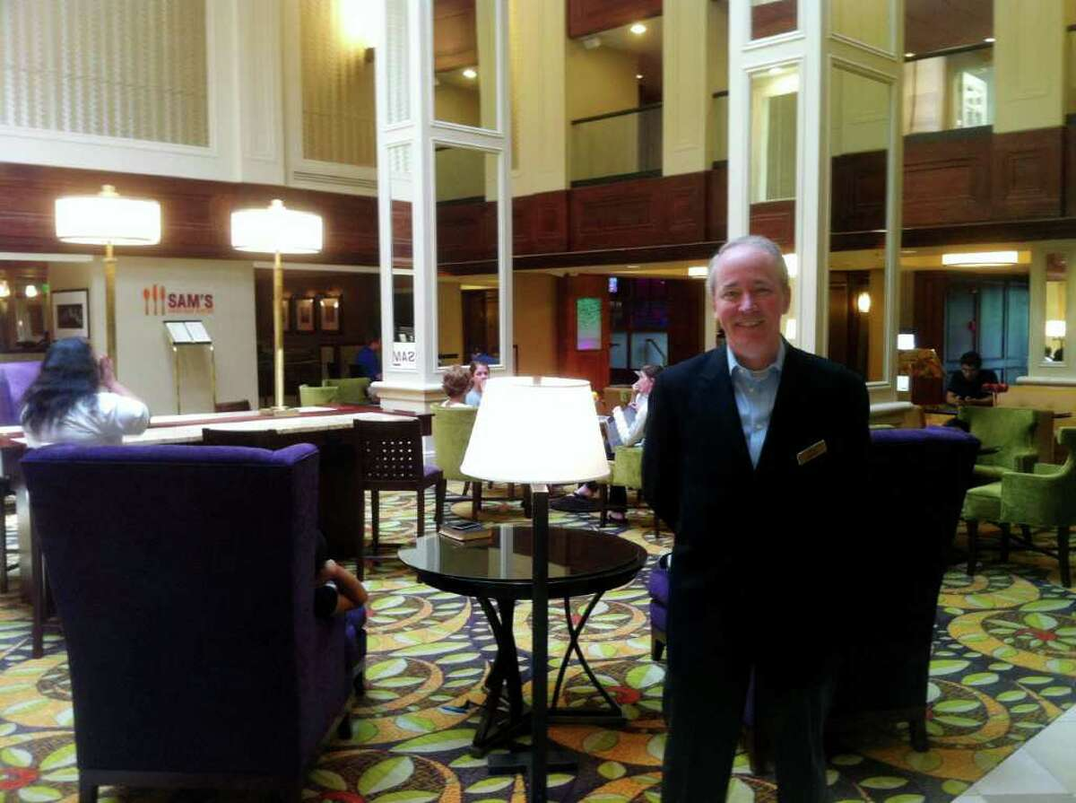 Joe Kelly, general manager of the Stamford Marriott, shows off the new-look lobby at the Tresser Boulevard hotel, part of a multi-million-dollar renovation project.