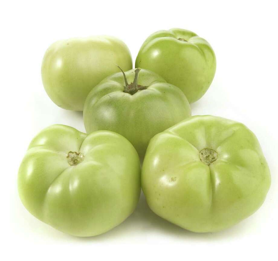 Green tomatoes can be found at specialty and farmers' markets and have a tart flavor perfect for frying or pickling. (Alex Garcia/Chicago Tribune/MCT) Photo: Alex Garcia, MBR / Chicago Tribune