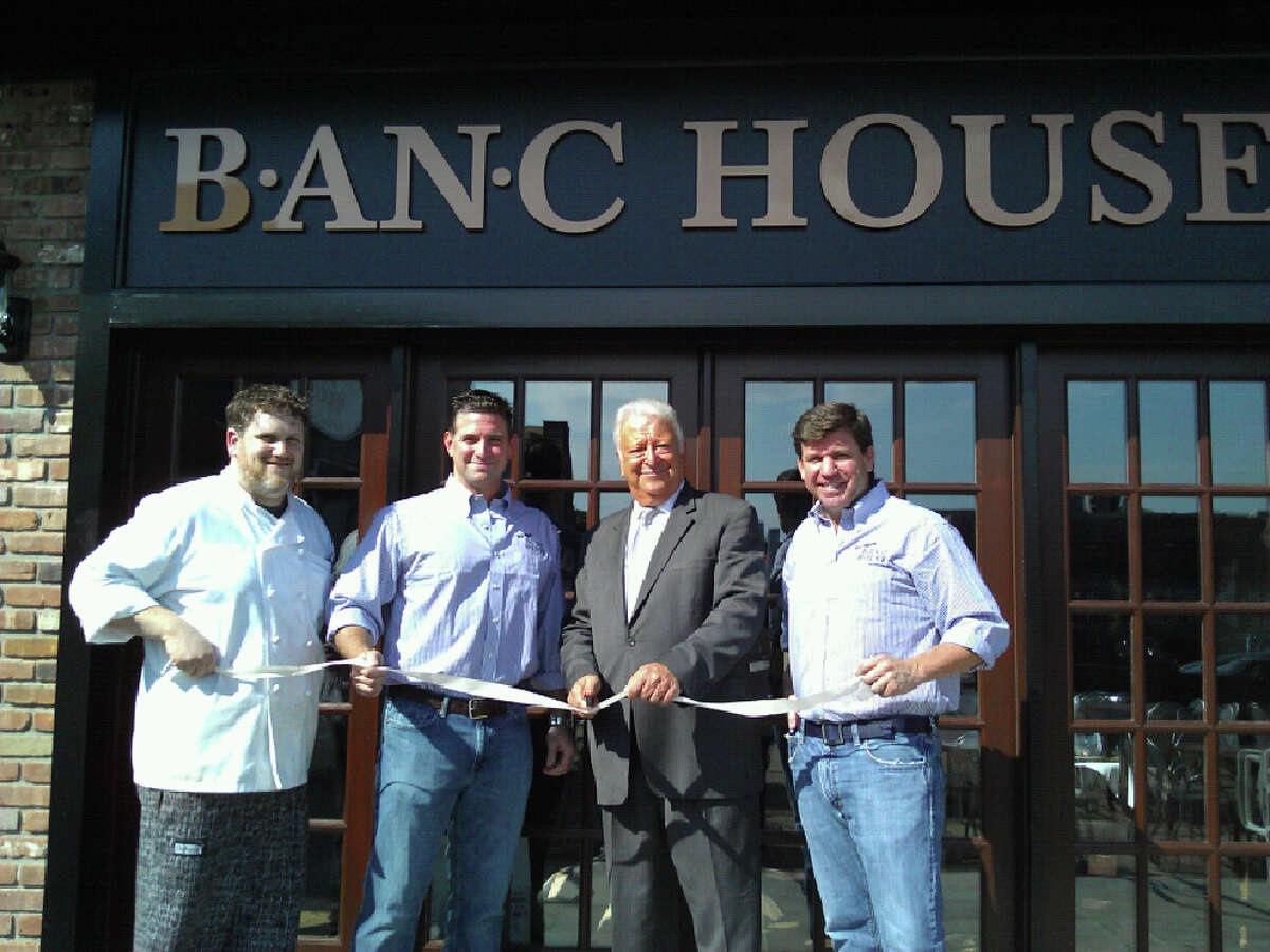 Chef Leland Avellino, B.J. Lawless, Norwalk Mayor Richard Moccia, and Buckley Ryan cut the ribbon to mark the opening of B.an.C House on River Street in Norwalk.