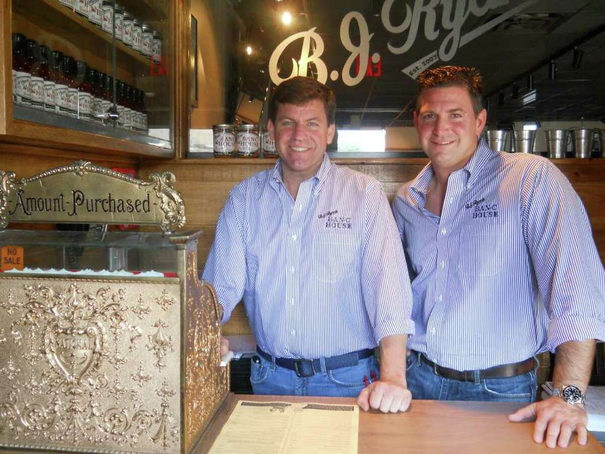 Buckley Ryan, left, and B.J. Lawless, owners of B.J. Ryan's restaurant in Norwalk, are depicted here in their newest eatery, a BBQ and crab house located on River Street.