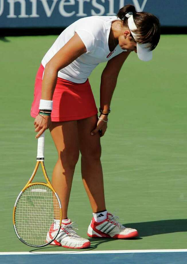 NEW HAVEN, CT - AUGUST 26:  Anabel Medina Garrigues of Spain grabs her thigh after losing a point to Amelie Mauresmo of France during the Pilot Pen Tennis tournament on August 26, 2005 at the Connecticut Tennis Center at Yale in New Haven, Connecticut.  Medina Garrigues was treated for cramps while Mauresmo went on to win 6-4, 7-6 (5), 6-2 to advance to the finals.  (Photo by Brian Bahr/Getty Images) Photo: Brian Bahr, Getty Images / 2005 Getty Images