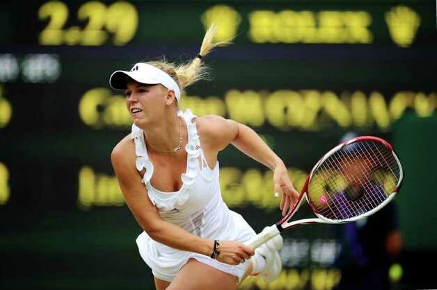 LONDON, ENGLAND - JUNE 25:  Caroline Wozniacki of Denmark  in action during her third round match against Jarmila Gajdosova of Australia on Day Six of the Wimbledon Lawn Tennis Championships at the All England Lawn Tennis and Croquet Club on June 25, 2011 in London, England.  (Photo by Clive Mason/Getty Images) Photo: Clive Mason, Getty Images / 2011 Getty Images