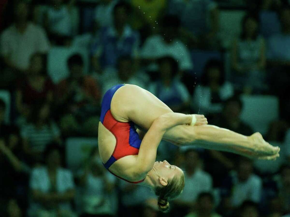 DIVING - Laura Wilkinson of The Woodlands, Texas dives during the women's 10 meter platform diving preliminaries at the 2008 Summer Olympic Games, Wednesday, Aug. 20, 2008, in Beijing. ( Smiley N. Pool / Chronicle )