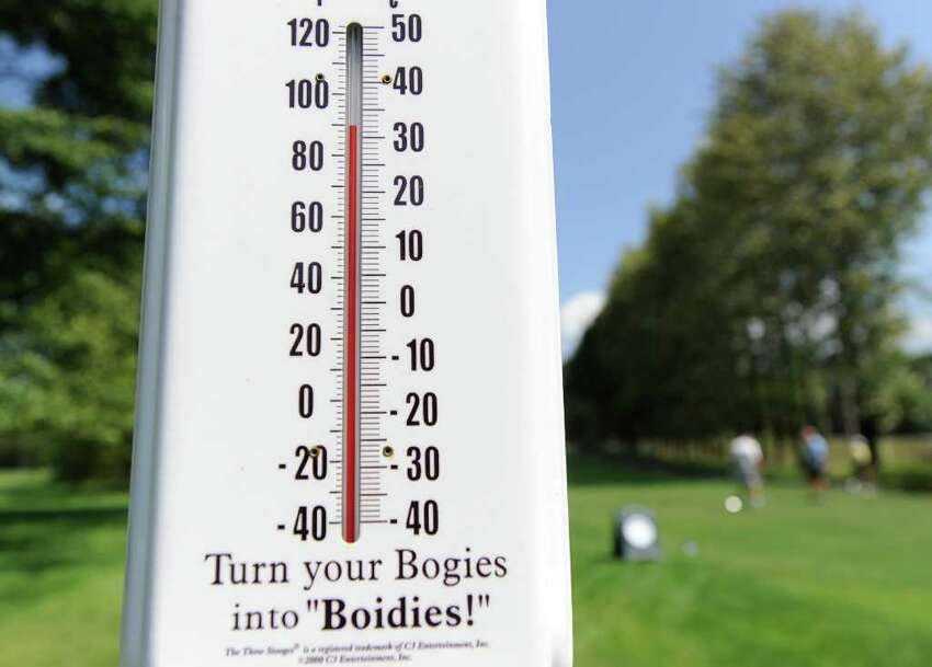 The temperature was above 90 degrees according to the thermometer at Griffith E. Harris Golf Course, Greenwich, during the Women's Town Golf Tournament Tuesday afternoon, July 12, 2011.
