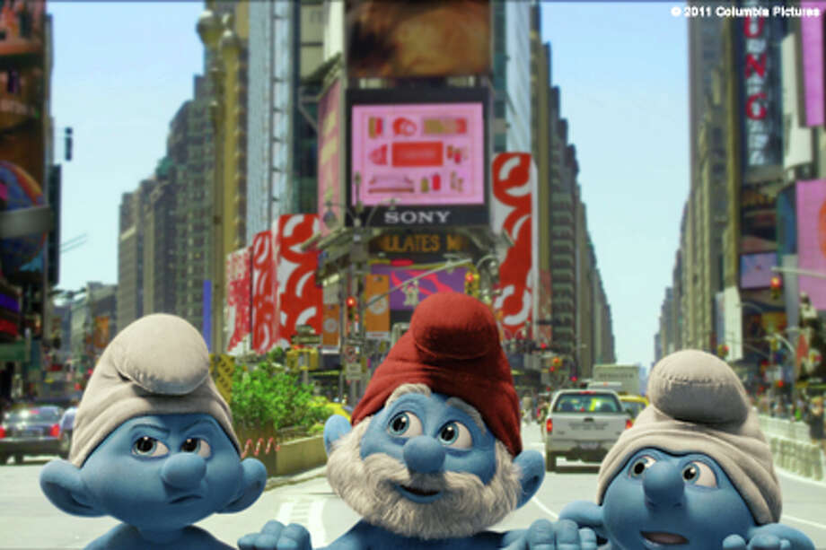 "(L-R) Grouchy Smurf, Papa Smurf and Jokey Smurf in ""The Smurfs."""
