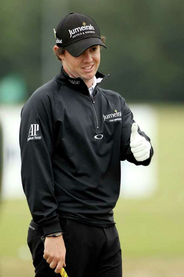 SANDWICH, ENGLAND - JULY 12:  Rory McIlroy of Northern Ireland waits on the practice ground during the second practice round during The Open Championship at Royal St. George's on July 12, 2011 in Sandwich, England. The 140th Open begins on July 14, 2011.  (Photo by Andrew Redington/Getty Images) Photo: Andrew Redington, Staff / 2011 Getty Images