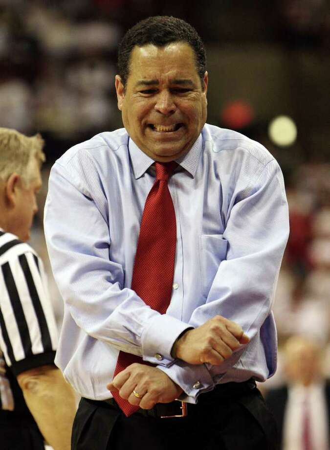 ** FILE ** Indiana head basketball coach Kelvin Sampson reacts to an official's call during the second half of their college basketball game against Ohio State, in this Feb 10, 2008 file photo, in Columbus, Ohio.  Sampson and his staff violated telephone recruiting restrictions imposed because of his previous violations at Oklahoma, then lied about it to the school and NCAA investigators, according to an NCAA report released Wednesday, Feb. 13, 2008.  (AP Photo/Terry Gilliam) Photo: Terry Gilliam, STR / AP