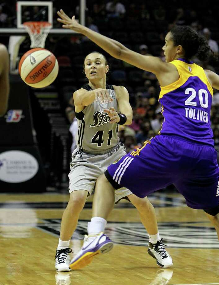 Silver Stars' Tully Bevilaqua (41) fires a pass against Los Angeles Sparks' Kristi Toliver (20) in the first half at the AT&T Center on Tuesday, July 12, 2011. Photo: Kin Man Hui/kmhui@express-news.net / San Antonio Express-News