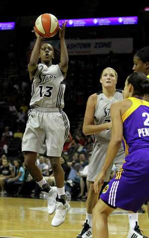 Silver Stars' Danielle Robinson (13) takes a mid-range jumper the against Los Angeles Sparks in the first half at the AT&T Center on Tuesday, July 12, 2011. Photo: Kin Man Hui/kmhui@express-news.net / San Antonio Express-News